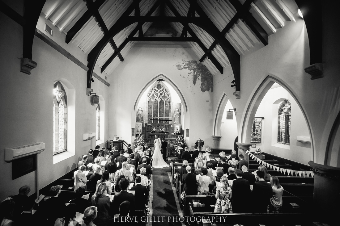 wedding ceremony inside the church black and white
