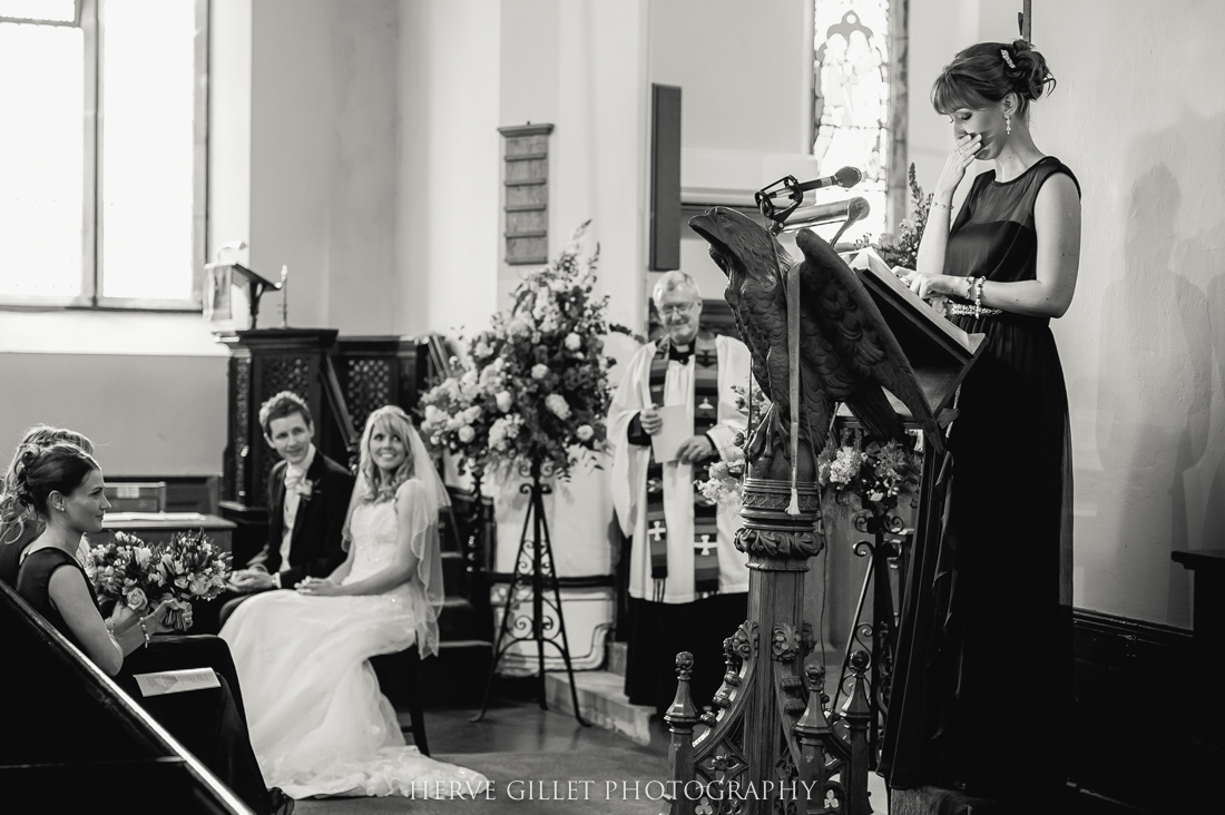 bridesmaid reading  at the wedding ceremony