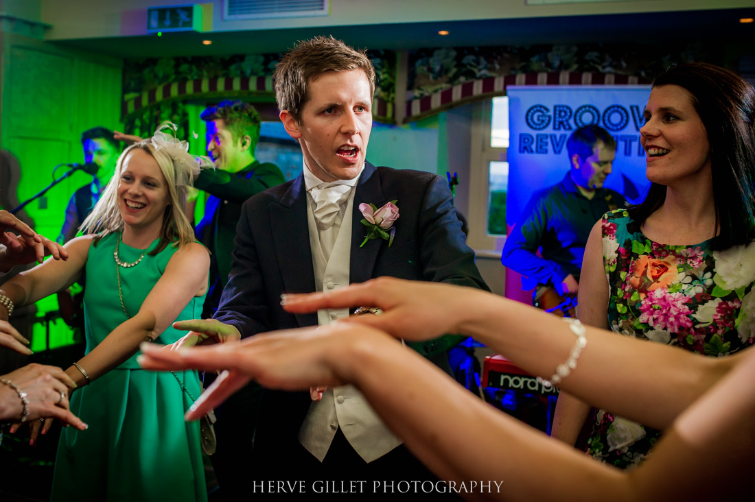 groom and guest waving them hands