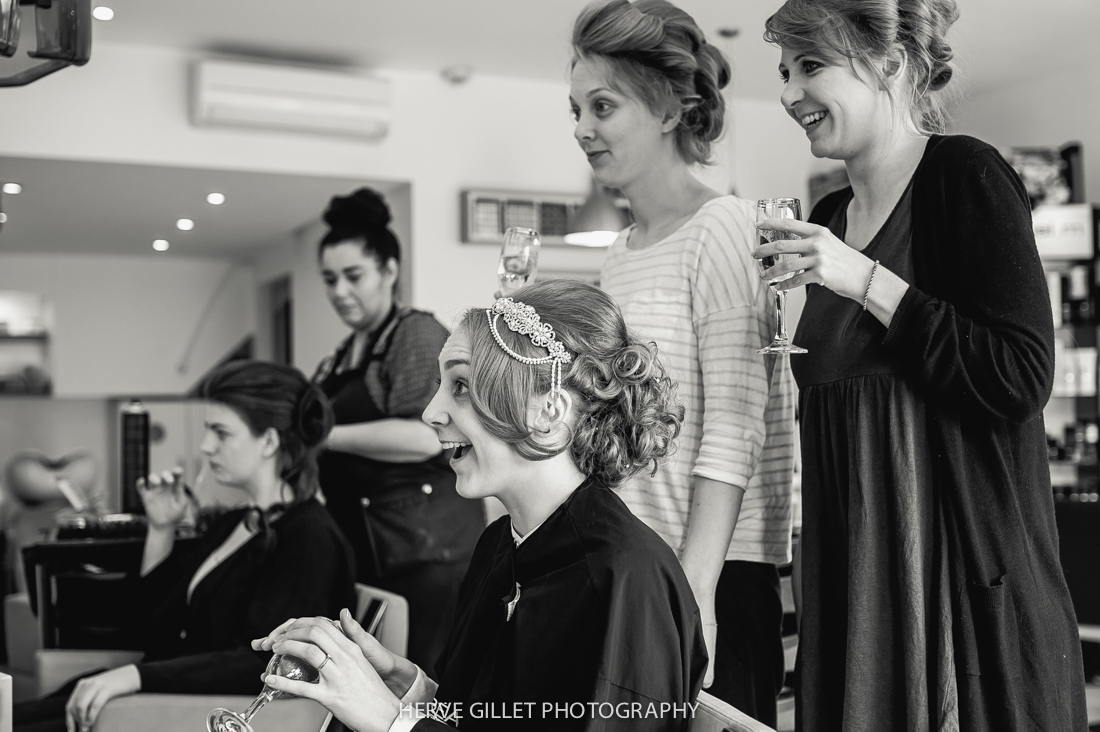 bride and bridesmaids at the hairdresser