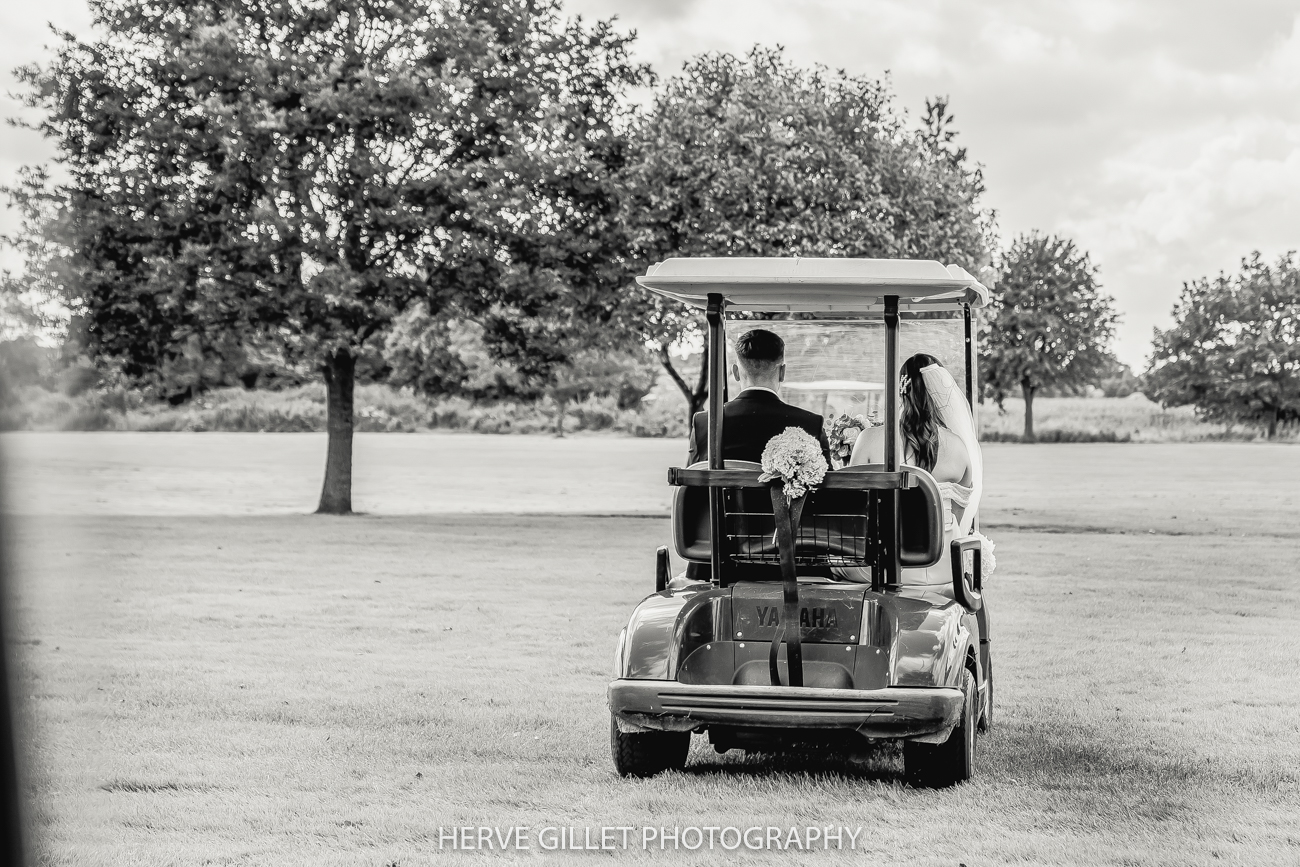 bride and Groom in the golf buggy Pryors Hayes wedding photography