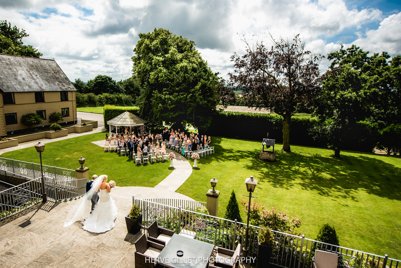 ceremony at the garden in the West Tower wedding photography
